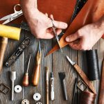 man-working-with-leather-P59HMFA-1024×690